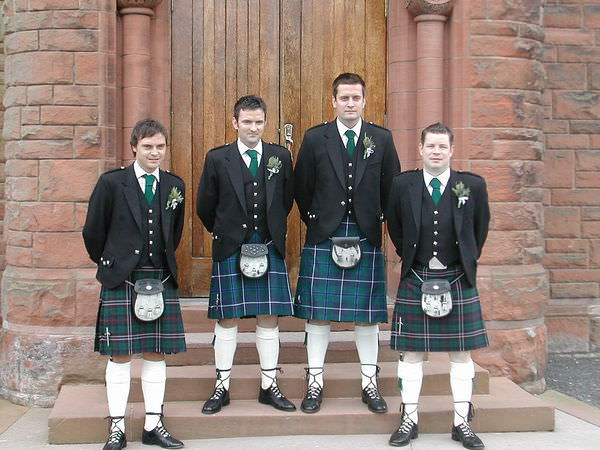 1024px-The_groom_and_his_best_man_and_ushers